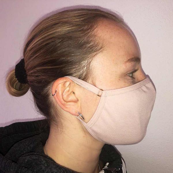 Mund- und Nasenmaske von Rosme in haut